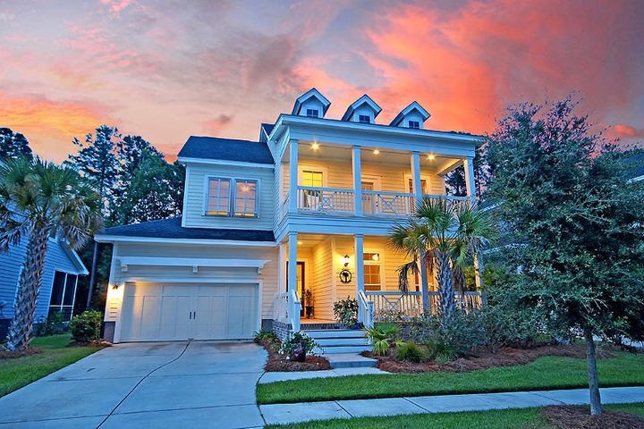 A true southern beauty! Double front porches, Bahama shutters, palm trees and a welcoming front porch!