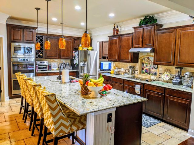 Home Features a Custom Gourmet Kitchen with Custom Tile, Granite Counter Tops and a Double Oven.