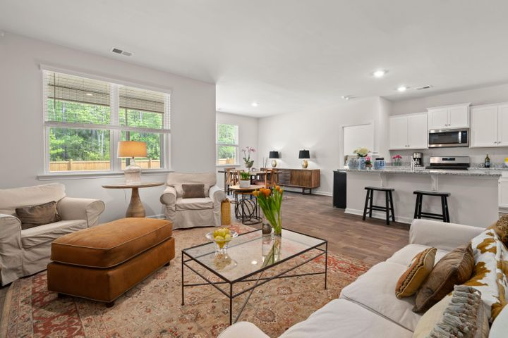 Spacious family room open to kitchen and dining room.