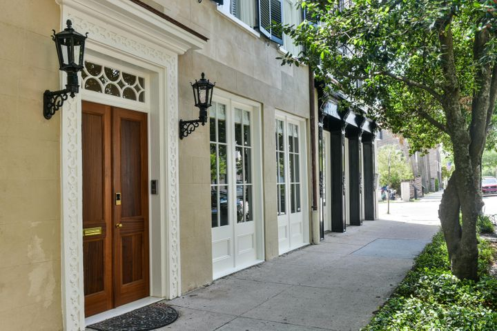 The grandeur of 90 East Bay, one of the rare surviving original wharf buildings of the 18th century in the city of Charleston, becomes evident while standing outside the grand entrance and turning the brass knob on the double French mahogany doors, encased in the original storefront trim, surround and beneath an intricately carved transom that fills the entry with light.