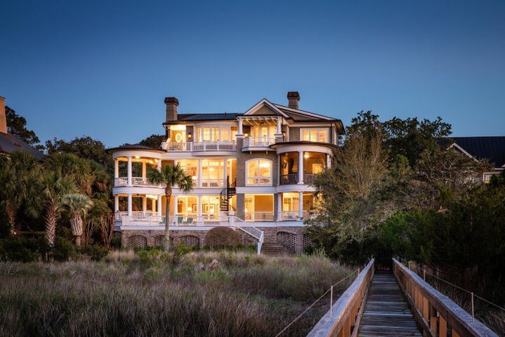 Spectacular deepwater home with a private dock on Kiawah Island, impeccably designed by architect Skip Wallace and expertly crafted by well known on-island builder, Solaris. If you are looking for an island lifestyle of fishing, boating, paddle boarding, kayaking and golf, look no further than this! It is very clear no detail was overlooked as you step inside this beautiful, three story shingled home with triple tiered decks, located on the peaceful and wildlife abundant Kiawah River. The first floor features a towering foyer with a beautiful grand staircase equipped with custom wrought iron railing. The first level floor plan offers a grand Club Room which is perfect for family gatherings and is beautifully designed with a coffered ceiling, triple crown moldings and custom pecan millwork.