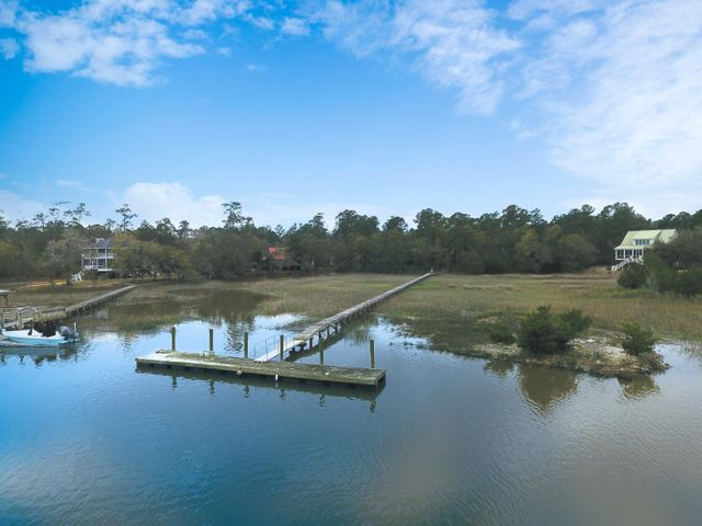 Combined lots for additional space. Deep water lot on Jeremy Creek with dock in Skippers Point area of McClellanville. Beautiful waterfront property ready for your dream home. Quick access to pristine beaches and waterways of Cape Romain , Bulls Bay and the Intracoastal. Come enjoy the great sense of community and quaintness this coastal Village by the Sea has to offer!