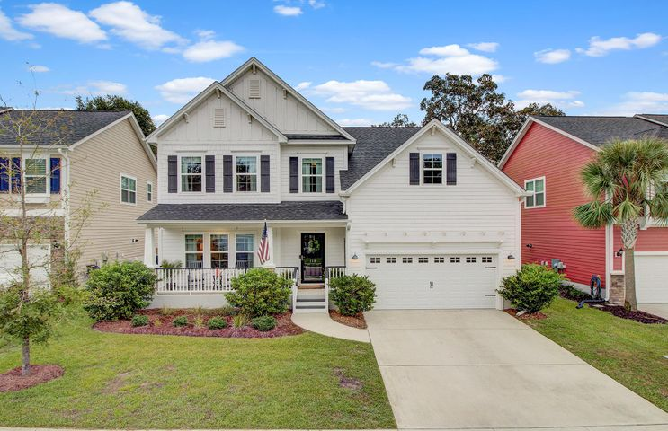 This charming home is conveniently located in The Bluffs at Ashley River which is a quaint community with easy access around town and into Charleston. The community boasts Lowcountry style homes and is within the sought after DD2 school district. It has 5 bedrooms, a home office, flex space/loft, open floor plan from family room to kitchen and large dining room. As you enter from the covered front porch into the foyer you will notice the beautiful hardwood floors that extend through all the downstairs and custom craftsman style millwork on the walls with hooks to hang jackets or backpacks. Off to the left is a spacious dining room with a farmhouse style chandelier and custom molding. Through the dining room, you enter the kitchen with granite countertops, stainless steel appliances and a subway tile backsplash. Take note the pantry is oversized and gives great extra storage. There is a raised bar for entertaining or grabbing a quick bite and a bay window facing the rear yard with a custom built-in storage bench for optimal seating and beadboard style wainscoting.  The family room is open to the kitchen and is centered around a gas fireplace and a bank of windows along the back.  The wiring is integrated for a wall-hung TV making for an easy setup. Also in the family room, there are built in speakers, dimming switch for lights, and is equipped with a work station for family organization. Just off the family room, there is an office/study space with an accent shiplap wall and built in shelving that can be used as a desk. The office is a perfect retreat for working from home or kids play area or even schooling from home. There is a glass panelled door leading from the family room to a screened porch which then leads to an extended patio and fenced backyard. The home is backed by community green space allowing for more distance between houses but also a great place for kids to play or throwing the frisbee for a dog. The 2 car garage has door opener and built-in shelves 