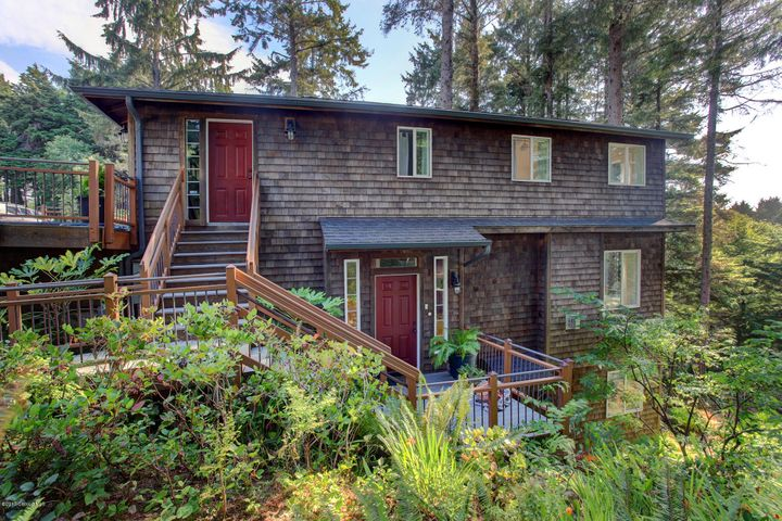 Nestled high above the tsunami zone this Cannon Beach home enjoys lovely ocean views and the sounds of the wind through the trees.