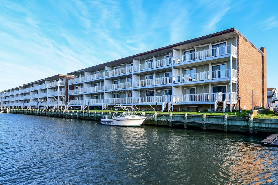 Spacious waterfront 2 bed 2 bath condo with many recent updates.  Large balcony overlooking the water which can be accessed from both living room and master bedroom.  Renovated kitchen with newer countertops and cabinets plus a large separate dining area.  Features include newer flooring, updated master bath & new through the wall heat pumps.  Boat tie up at just $100 for the season.  Great location with easy access to the bay and close to the beach, shopping and restaurants.  Put this on your priority list.