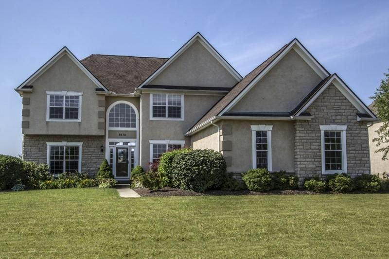 Stone & stucco exterior, asphalt drive, lamp post, front storm door, coach lights, keyless entry, pond view, treed lot, 6 panel doors, security system, new outdoor living spaces ~2014, new front & rear storm doors ~2014, new front door ~2014, new roof ~2015, 2' extension to Side of Home   9512 Emerson Drive, Powell, OH 43065
