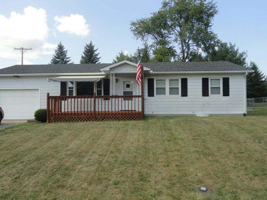 Front porch is complete with a remote controlled awning! | 631 Oakland Avenue, Bellefontaine, OH 43311