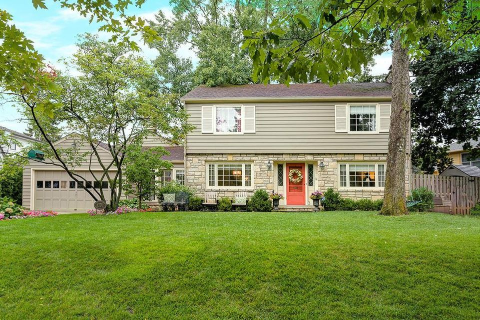 Welcome to 1701 Guilford Road! This classic home South of Lane is just steps from Barrington Elementary School, Jones Middle School, Lane Avenue Shopping Center and the UA parade route. It boasts a traditional floor plan with generous living and family rooms, a formal dining area as well as an eat-in kitchen. Convenient mudroom connects kitchen to side and garage  entrances. The upstairs has rich hardwood floors, two spacious bedrooms, plus a large master suite with generous closet space. Master bath has been tastefully updated. A composite deck and flagstone patio with built-in fire pit overlook the large backyard, which is perfect for entertaining and kids. A new fence and trees surround the yard, allowing for plenty of privacy. Move right in and enjoy!