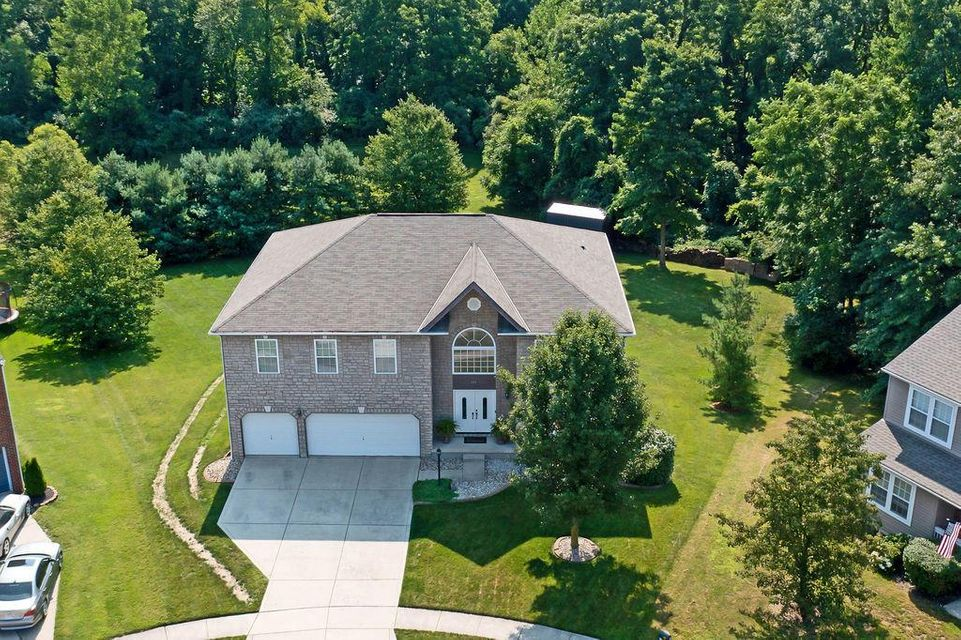 • Stone & Vinyl Exterior • Concrete Driveway • New Composite Deck ~ 2020 • Invisible Fence • Front Lamp Post • Porch Lights • Keyless Garage Entry • Coach Light • New Patio ~ 05/2021 • Yard Building • White Six Panel Doors • Backs to a Preserve • End of Cul-de-sac Lot • Upgraded Exterior Elevator • New Samsung® Refrigerator ~ 2020 • New Samsung® Electric Range ~ 2020 • New Samsung® Dishwasher ~ 2020 • New Samsung® Microwave ~ 2020 • New Luxury Vinyl Plank Flooring in Half Bath, Kitchen, & Dinette ~ 2018 • New Neutral Vinyl Flooring in Lower Level ~ 2019 • Loft/Den • New Front Door ~ 2019 • New Granite Countertops in Kitchen ~ 2017 • New Two Guardian® Electric Door Openers ~ 2018 • New Tan Carpet in Bedroom #2 ~ 2019 • New Lighted Ceiling Fan in Bedroom #2&3 ~ 2019 | 101 Deer Path Court, Etna, OH 43062