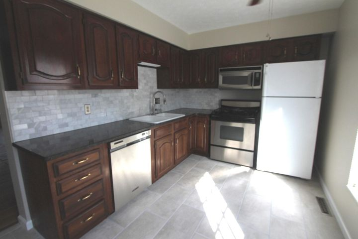 Completely updated with tile backsplash, ceramic flooring, stainless range, microwave and dishwasher and ceiling fan!