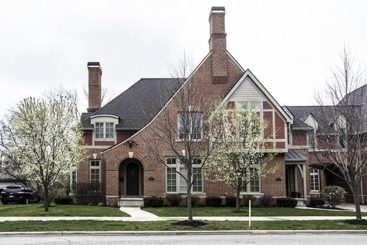 Brick exterior, fenced, rear paver patio, Honeywell security system, future elevator shaft, Screened Porch, upper level Den & Guest Suite/Bonus Room, white, 6 panel doors, lever locks, fire suppression system, hardwood flooring on main level, Great Room with fireplace