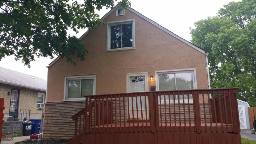 Super Cute Cape Cod, Stucco & Stone, Freshly Painted, Large Deck, New Windows, New Doors, & Exterior Lights!!