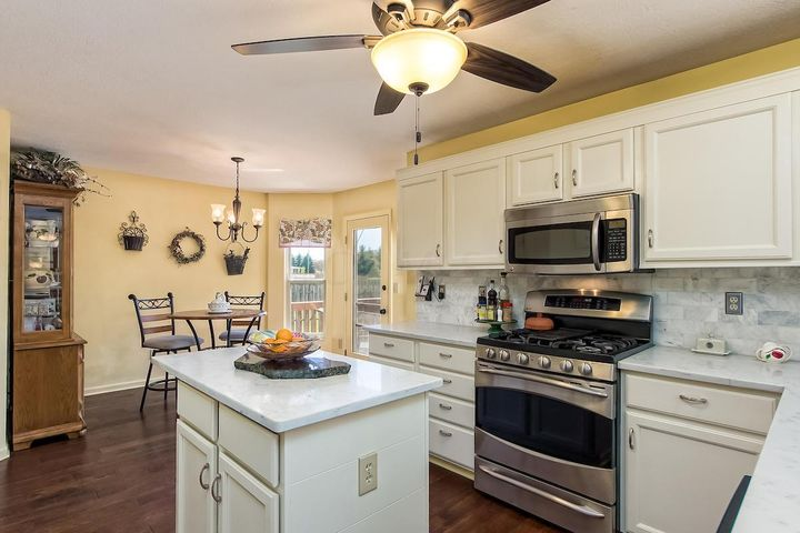 Quartz countertops and island with gas stove (double oven with super burner)
