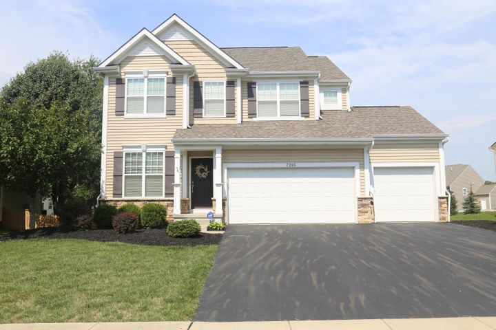 This is a beautiful 5 - level split with 3 car garage and stone water table! 2918 square feet!