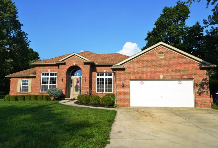 Full brick face, concrete drive, exterior coach lighting, fully drywalled garage.