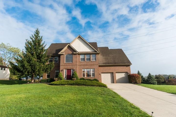 All brick and stucco home that sits on a 1.75 acre tree-lined lot.