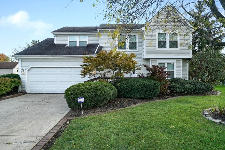 Professionally landscaped large lot being 1/3 of an acre!