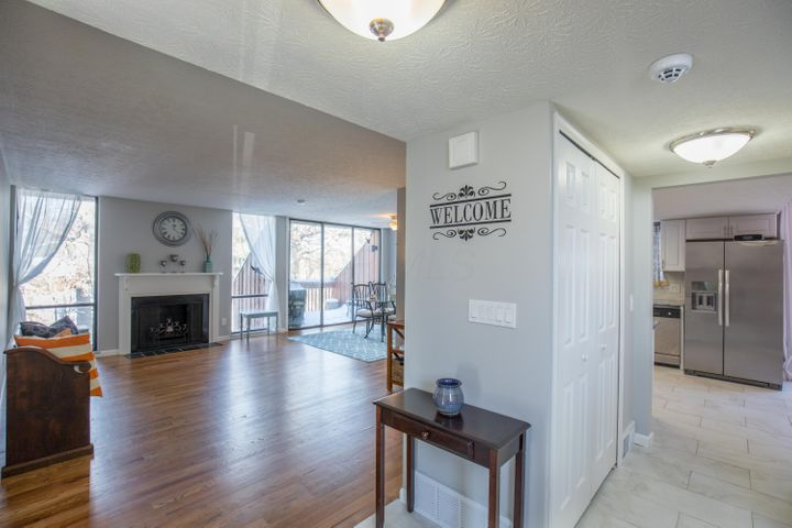 Spacious entry with tile floor, overhead light, and pantry/coat closet.