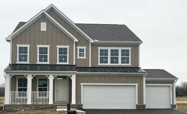 Vinton II Floorplan. Hardie Plank siding. 3 car garage