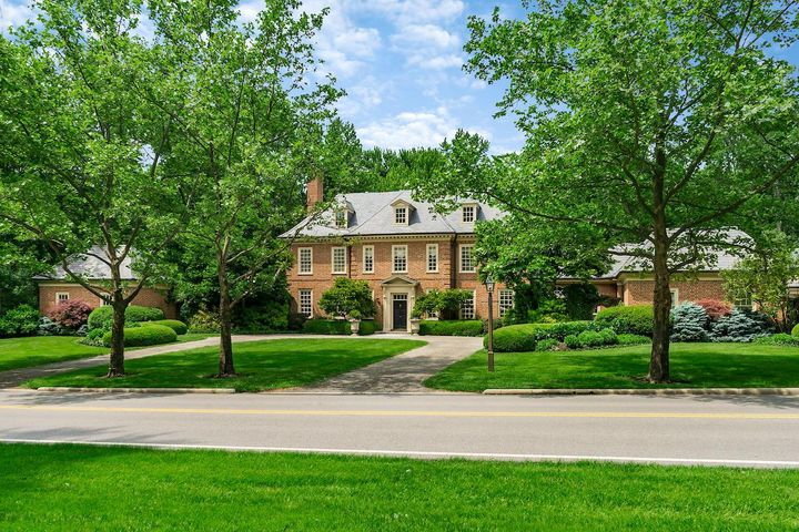 Quintessential all brick Georgian Colonial by Master Craftsman Kevin Knight. Architecturally designed by Bryan Kent Jones.