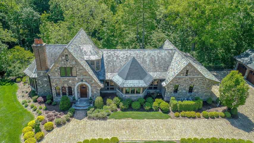 • Stone & Stucco Exterior • Paver Drive & Courtyard • Wooded Lot • Slate Roof • Copper Gutters & Roof • Redwood Soffits • 2+ Car, Side Entry Attached Garage • 3+ Car, Side Entry Detached Garage • Camera System• Irrigation System• Slate Patio• Screened Porch