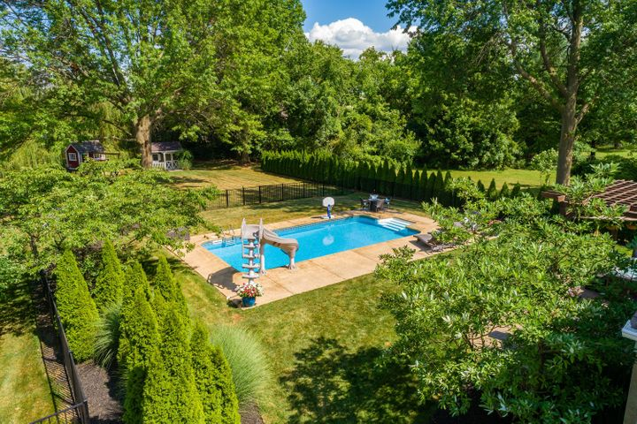 Outdoor entertainment at it's best with a private paver patio, in-ground pool, hot tub and outdoor tv.