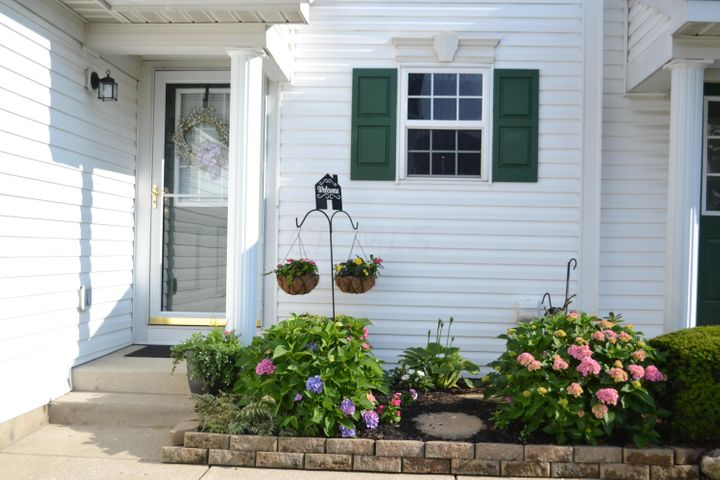 front entry with beautiful landscaping