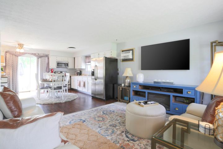 Beautiful open concept living room and kitchen greet you as you enter!