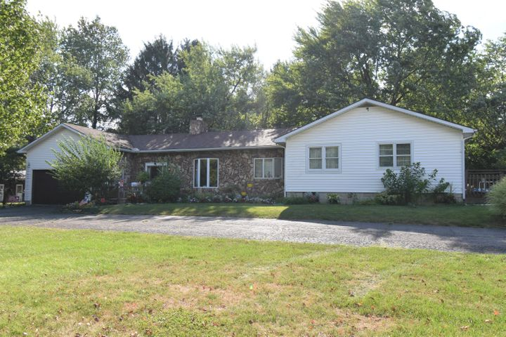 Lovely one story home with 2,452 square feet, attached garage w/side mother in law suite, storage shed and large pole barn.