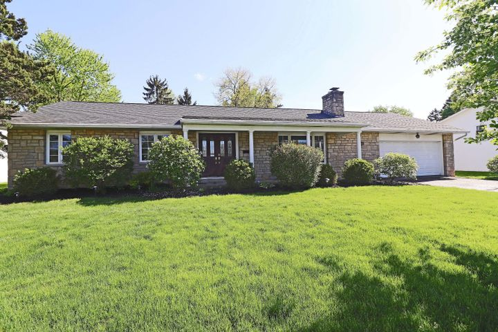 Seize the opportunity to own and live in this prestigious home on one of the East Gateways into Upper Arlington. Just minutes away from the Ohio State University, Downtown,Short North and more.  Mid Century meets modern in this stately stone and stucco ranch home. It boasts a beautiful, large fenced backyard with a brick patio, a new driveway, large updated kitchen with stainless gas range, granite countertops and new cabinets. There are 4 bedrooms, wood and travertine floors, newer windows, sophisticated stone fireplace in the large living area, large formal dining room, and 2 chic vintage full baths.The large basement has a 1/2 bath and encapsulated crawl space. Move right in and enjoy!