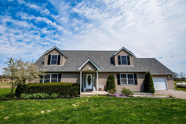 Welcome to country living, in this beautiful cape cod home nestled on 3.48 acres. The first floor has an open concept with the kitchen, dining and living room flowing together, along with large front room that can be used as an office, playroom or whatever your heart desires. The first floor master is spacious with an ensuite bathroom, and plenty of storage. The 2nd floor bedrooms are vast, airy and have lots of natural light! The home theater and walk-in storage (great for stashing snacks!) make the basement the place to hang out. Paired with 3 additional rooms, you can create your own home gym, office, etc.The property includes the parcel directly next door, and is 1.74 acre. It is residentially zoned, and can be sold in the future if ever desired.