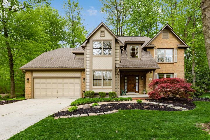 You'll feel right at home the moment you step into this quality home. located in prime Dublin neighborhood.  Handsome wood work with dental and crown moldings, solid surface counters, stainless appliances, real hardwood floors, new deck and 9 ft ceilings .  Freshly painted and updated throughout.   Formal Living & Dining Rms,  Kitchen opens to large Family Room w/ masonry fireplace.  First floor Office and Laundry.  Huge Master Suite w/ sitting room and walk in closet to die for!  Master Bath has been updated with new shower surround , dual sinks and whirlpool tub.  Secondary Bedrooms are good sized and hall full bath has been updated as well.    Peaceful nature surrounds with wooded level lot.  Roof 10yr, HVAC 3 yr , Newer exterior paint & gutters , new carpet 2nd floor.