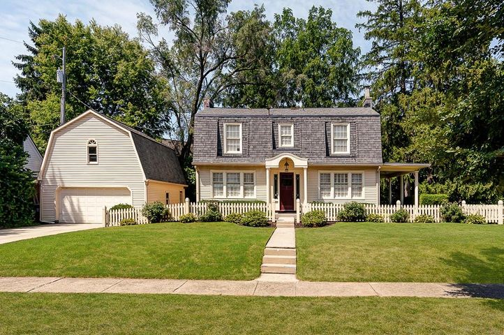 Opportunity awaits in this already beautiful historic home situated on a large corner lot South of Lane. Spacious center hall foyer welcomes you inside and dramatic lead glass paned windows at the top of the stairs offer an abundance of natural light. The first floor boasts a living room w/ access to covered side porch, oversized dining room w/ corner cabinet and the kitchen. Upstairs offers a generous sized master w/ ample closet space, two additional bedrooms (one currently used as an office) and a full bath. LL offers an additional 400+ sq ft of living space, full bath, laundry & storage. Oversized 2 car garage w/ full storage space above. Move right in and enjoy or add on/renovate as many neighboring homes have done. Steps away from Miller Park & library and close by UA Mallway.