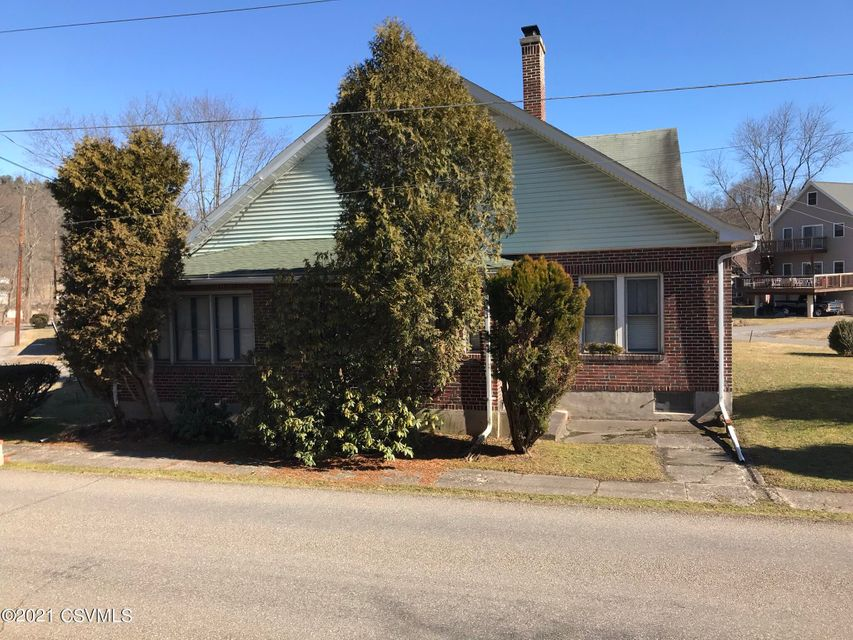 Corner lot home with multiple buildings included!