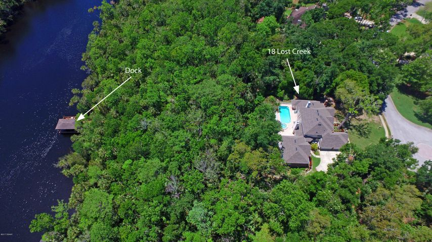 Tomoka River Estate on over one acre of land w/dock & boathouse. Lost Creek Estates is an area of Tymber Creek with a collage of beautiful estate homes - All unique and different.
