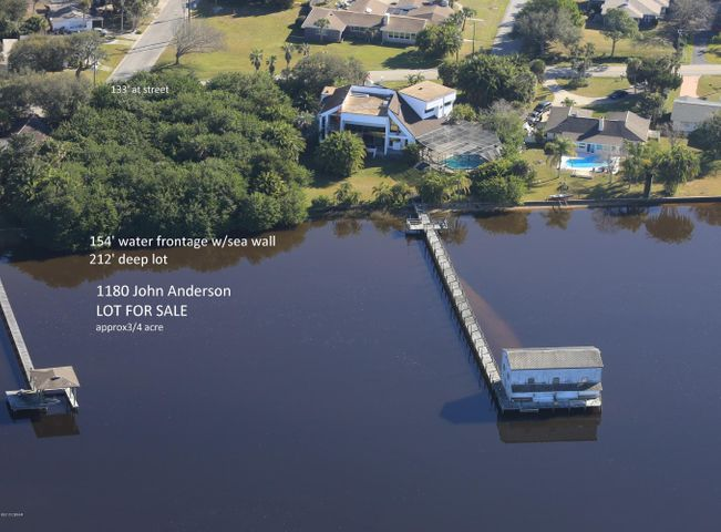 Over 3/4 acre wooded lot on John Anderson Drive. 154 ft of direct water frontage on Intracoastal waterway with seawall. 212 ft lot depth with 132 ft road frontage.