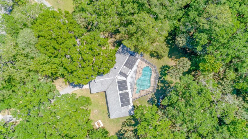 Five acre lot with mature trees give a lovely dappled light and privacy