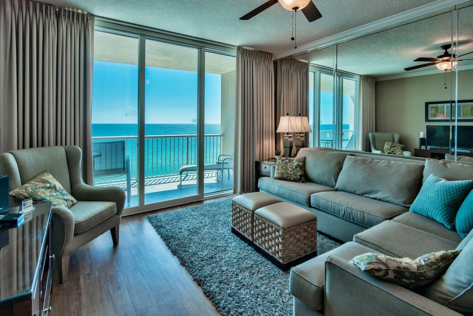 If you are looking for that one-of-a-kind luxury condo offering features that are unmatched along the Emerald Coast, then this is the perfect oasis for you to escape. Unit #1007 is the best priced 3-bedroom unit at Palazzo and is in a great location of the building. Enjoy incredible views of the Gulf of Mexico through the floor to ceiling sliding glass doors & windows. Access a spacious 246 sq. ft. balcony from the living area and master bedroom, which is the perfect place to relax, dine or entertain. This upscale unit offers updated beautiful wood flooring (high-end laminate) in the living area and bedrooms and tile in the entry, kitchen and bathrooms. It is being sold fully furnished and has been decorated professionally with an inviting color palette, great furniture & flat screen TVs. Interior features include raised ceilings, crown molding, an open floor plan and recessed lighting. Capture Gulf views from nearly every room including the kitchen, dining area, living area and master bedroom. The open kitchen features thick solid granite countertops & wraparound breakfast bar and plenty of storage with ample hardwood cabinets and pantry. There is a dining area for 6 with Gulf views and a great living area with plenty of room to relax. A wall of mirrors opens up the room and captures the views.   The Gulf front master bedroom has direct access to the balcony, beautiful updated flooring and crown molding. It offers a king bed, flat screen TV, walk-in closet and en-suite master bathroom. The bathroom is quite large with a double vanity, Whirlpool tub and separate walk-in shower. The guest bedroom also has an en-suite bathroom and wood floors along with a queen bed and flat screen TV. There is an additional guest bedroom with two twin beds and another guest bathroom with pedestal sink and walk-in shower. This unit sleeps 8 guests and has a full size washer/dryer closet with storage. It is a great income producing rental unit but would also make a perfect full-time resident, as this is a lower density building for Panama City Beach.   Palazzo amenities include an elevated Gulf side pool, hot tub along with a boardwalk and designated beach with complimentary beach service (Mar-Oct). The fitness facility and on-site lobby is Gulf front and there is a meeting room available. The HOA is established and does a phenomenal job of keeping the building maintained. At Palazzo, you are on the desirable West End of Panama City Beach just 1 mile from Pier Park shopping center and less than 20 minutes from the Panama City Beach International Airport. Unlike the competition, Palazzo is a low-density building consisting of only 129 direct Gulf Front units and has four levels of covered Gulf Front parking under the building - no need for massive parking garages with elevated walkways across the street. Do not miss out on this incredible opportunity to own an affordable 3-bedroom unit at one of the finest condominiums in Panama City Beach!
