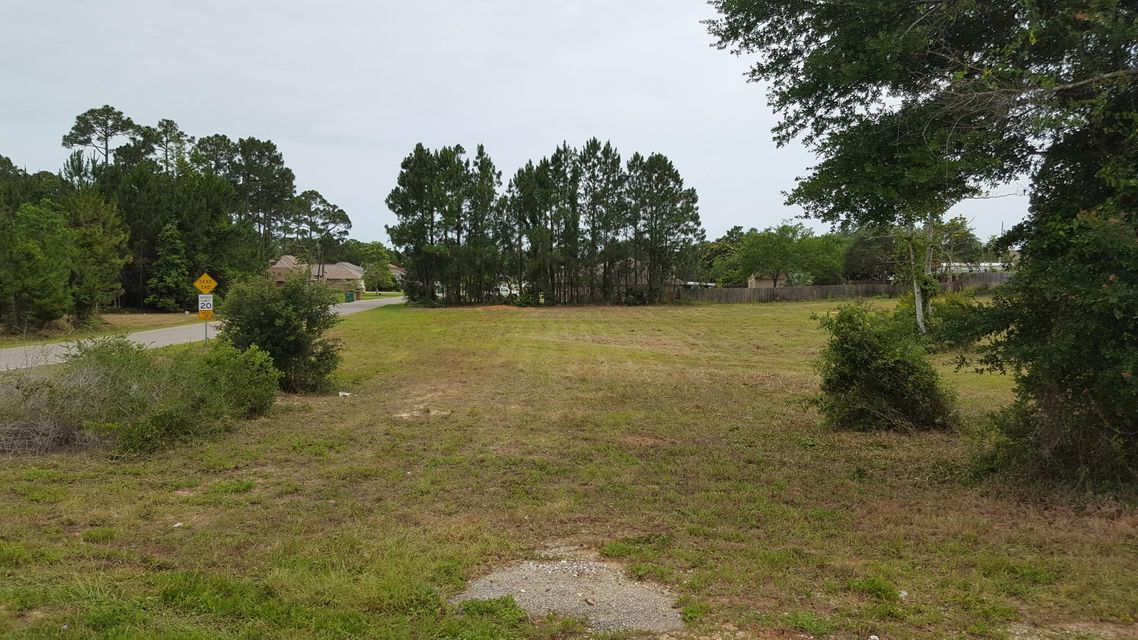 . New Lower Price for this Great high and dry corner lot near high producing Whataburger Restaurant in Navarre! Owner is serious about Selling Now! Soon to be completely cleared with maximum exposure for a business, fast food service, restaurant or retail strip center. The front 200' of dept is zoned Highway Commercial Development(HCD). The rear 70' is zoned residential R1 which can be used for holding ponds and possible parking. Conditional use variance possible with different needs.