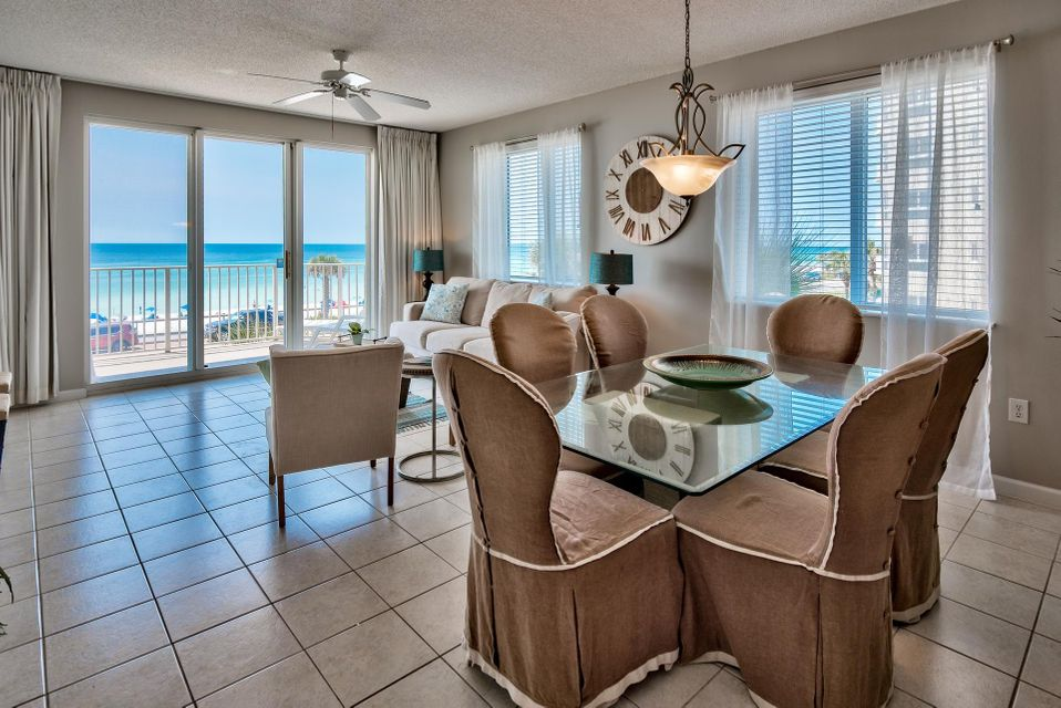 Remarkable 3-bedroom, 3-bath Gulf view condo at Majestic Sun. This is a highly desirable end unit offering unobstructed panoramic views of the Gulf of Mexico. It is the ONLY 3BR AVAILABLE & includes covered parking space B40. Interior has just been updated with brand new paint and was professionally  decorated. Not only do you have stunning views of the Gulf of Mexico, but the calm coastal colors extend inside the condo for an inviting atmosphere. Access the private balcony from the living area or master bedroom - the perfect place to relax, dine or entertain. Being on the second level and right across the street from the beach, you are able to hear the sound of waves crashing, transcending you to a relaxed state. Tile floors extend throughout the unit for easy maintenance by the beach! The interior offers a spacious & open floor plan, raised ceilings and beautiful touches like white wainscoting in the living area. There is great natural light with the additional windows for an end unit. The kitchen is a nice size with ample cabinets, pantry & raised breakfast bar for casual dining. The master bedroom faces the Gulf with exceptional views along with balcony access, a walk-in closet and en-suite bathroom. The master bath offers a double vanity. The split floor plan allows privacy and the guest bedroom also has an en-suite bathroom. The additional guest bedroom offers double bunk beds allowing this unit to be a great rental property. There is conveniently a laundry room with full sized washer & dryer. All appliances, furniture and new decor convey.   Majestic Sun is a premier destination within Seascape Resort, a gated golf, beach & tennis resort in Miramar Beach. At Majestic Sun, there are many amenities including convenient beach access across the street, a heated indoor/outdoor pool - a rare treat - expansive pool deck with two Gulf view pools, waterfall accents and whirlpool. There is a fitness center for owners and guests and covered parking & skyway for the comp