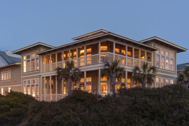 Evening view of this distinctive home from the beach.