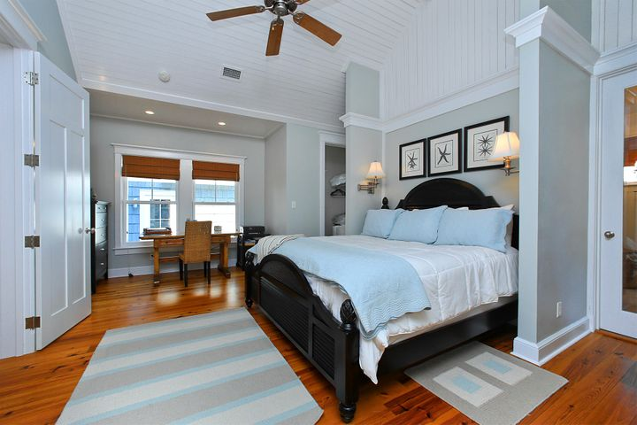 Master bedroom suite with elevated ceilings.