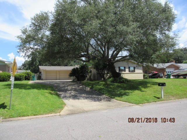 Front of home from street with beautiful mature oak