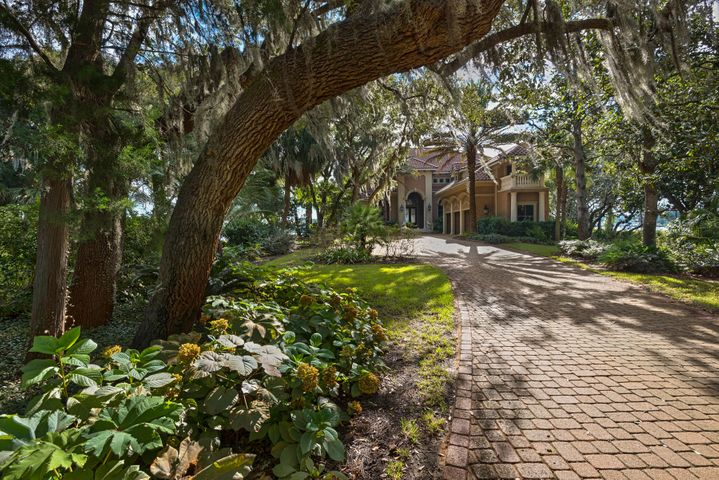 A tree covered picturesque setting! .78 of an acre, 147' of deep water Bay frontage and a 70' dock!