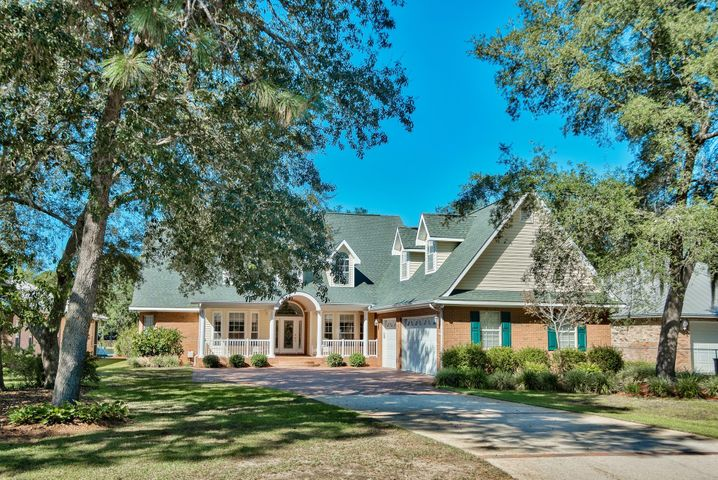 Great curb appeal from street with long winding brick driveway