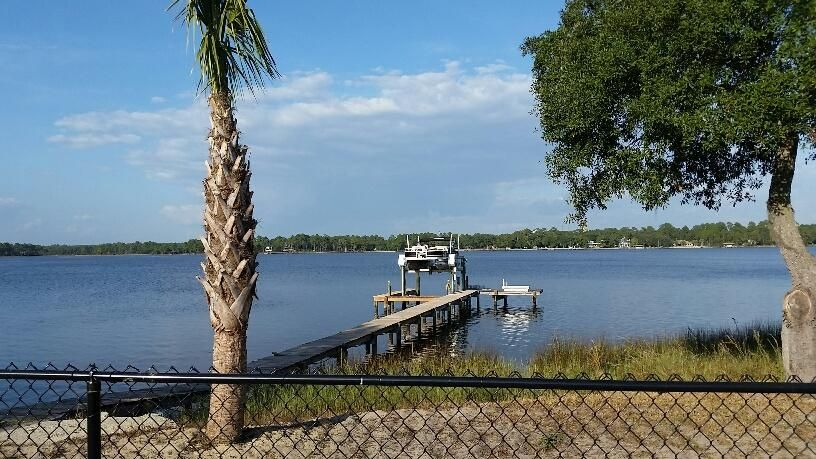 Bay View from the back yard. Black chain link fenced in area large enough for a Pool.