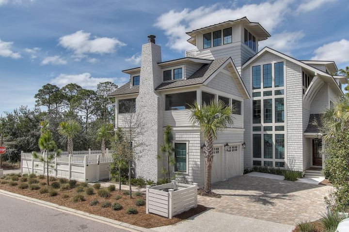 Cape-cod inspired, massive floor to ceiling windows, side entry garage, gas lighted entry