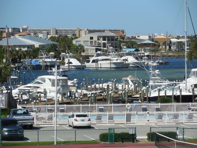 Harbor views and more...in this affordable condo in prestigious Sandpiper Cove Resort