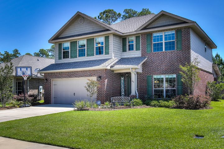 Beautiful curb appeal and well lanscaped 2 story home.