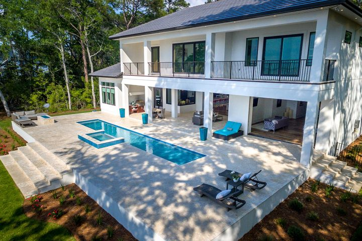 Bayfront oasis features an infinity pool, elevated spa and fire pit.
